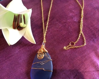 Long statement wire wrapped sea glass pendant very pretty blue