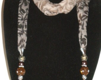 Brown scarf with beading.