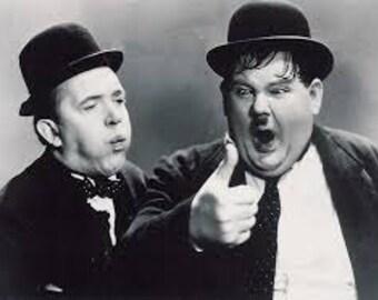 Laurel & Hardy Thumb Lighter. Fridge Magnet