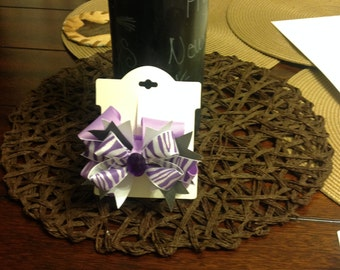 Purple and white zebra bow