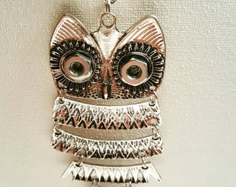 DareByKionde wise old owl necklace