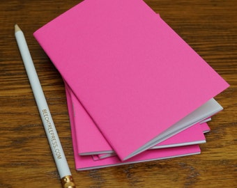 Five fluorescent card stock notebooks with blank pages. Small jotter journal with stapled spine. Use as a diary, logbook or sketchbook.