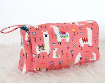 Nappy bag with alpaca, coral background
