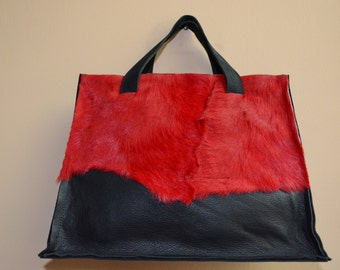 Black handmade handbag with red accent