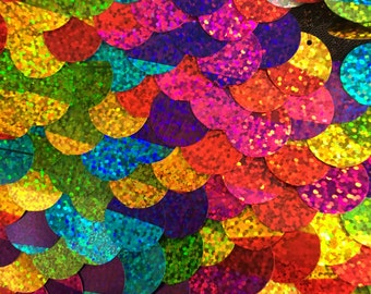 Multi color and silver paillette 20 millimeters sequin on mesh fabric sold by the yard
