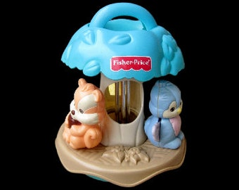 Old toy Fisher Price. Toy culbuto. Musical toy. Tree. Bird. Squirrel. Bear. Vintage toy