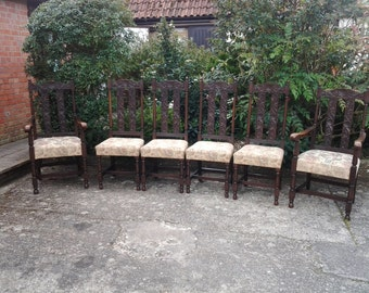 A gorgeous set of vintage dining chairs, carved detail, original fabric