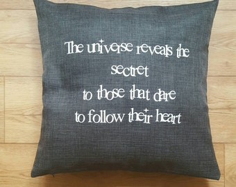 Dark grey throw pillow. Also check houseofaudacious.com for more items.