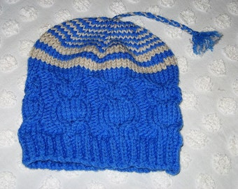 Tasselled Cable Hat