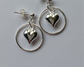 Sterling Silver, circle and puffed heart earrings