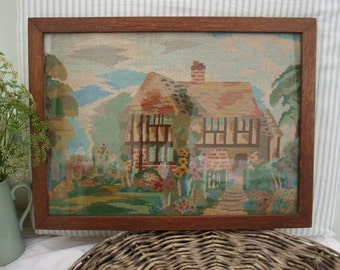 Vintage 1930s needlepoint,tapestry  cottage picture in wooden frame.
