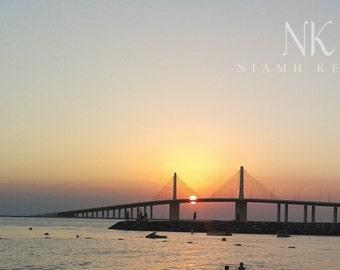 sunset sky bridge fishing