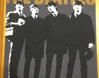 The Beatles ... black suits
