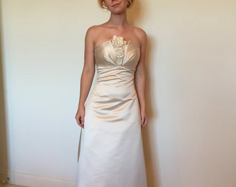 Size 0 Strapless Ivory Satin Wedding Gown with Added Flower Embellishments