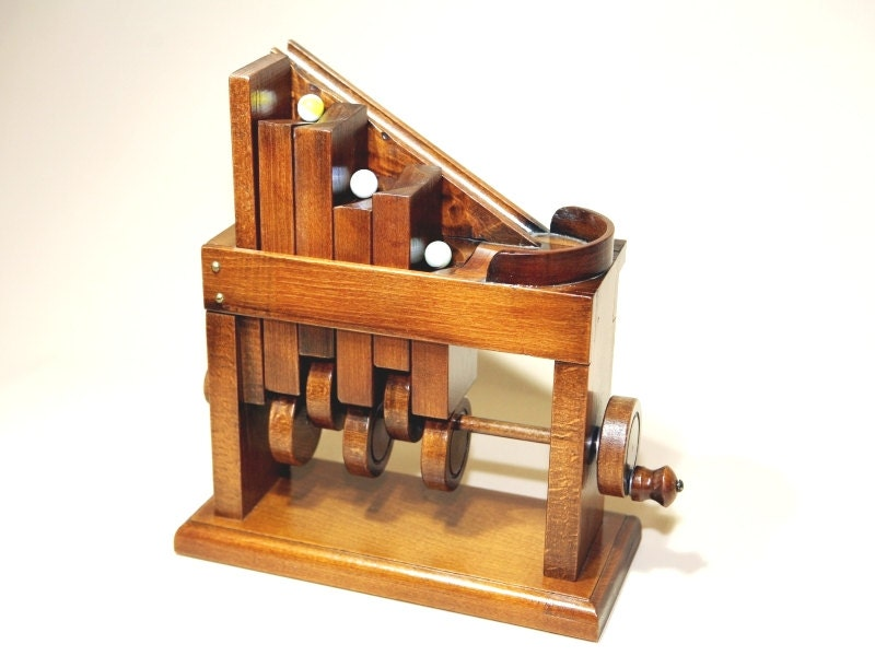 Marbles automata. Wooden automatism Kinetic art Wooden