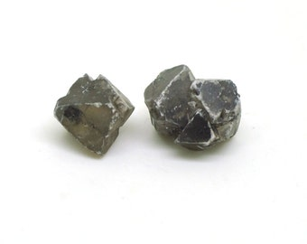 Senarmontite (x 2), Algeria, 8 and 10mm