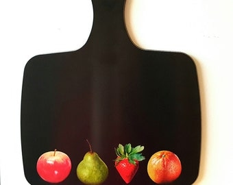 Fruit selection - Apple, Orange, Pear, Strawberry - chopping board