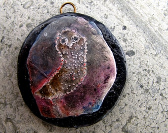 Framed dark owl polymer pendant on a dark back ground