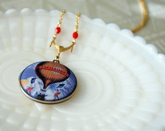 French vintage hot air balloon locket with red bead detail
