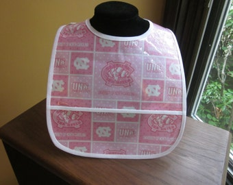 WATERPROOF WIPEABLE Baby to Toddler Wipeable Plastic Coated Bib University of North Carolina Tarheels in PINK