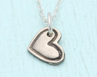 TINY MICRO HEART necklace, eco-friendly nickel free white bronze pendant. Handcrafted by Chocolate and Steel.