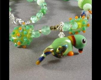 Lampwork Parrot Charm Necklace BY Cornerstoregoddess