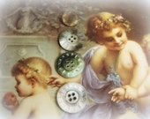 antique mother of pearl buttons . carved smoky mother of pearl buttons