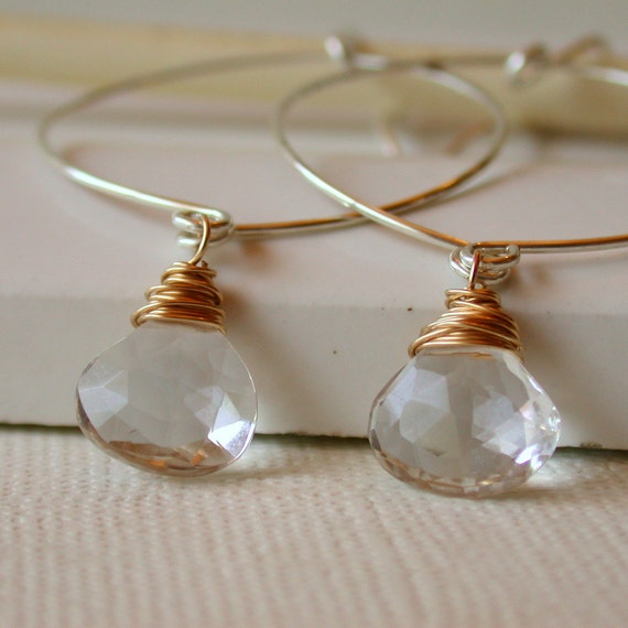 Sale. Crystal Quartz Hoop Earrings. Hammered Hoop Earrings. Round Hoop Earrings. Crystal Clear Drops. Dangle Earring. Drop Earring. Artisan.