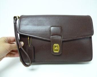 COACH . dark brown leather clutch . purse . wristlet