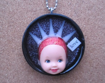 Love Beam - upcycled Little Kelly face Pendant