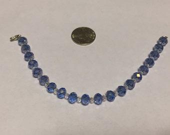 Lovely 8mm blue and 4mm clear Swarovski crystal bracelet