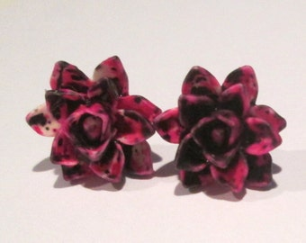 small pink, black, and white splatter design lotus flower pierced post hand made earrings by Ziporgiabella
