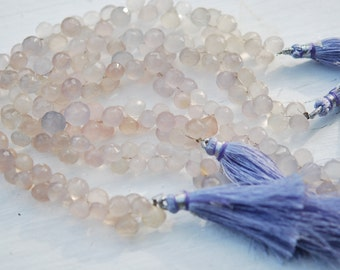 1/2 strand of natural chalcedony onions with a tint of purple