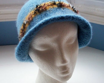 Hand knitted boiled wool felt hat, Downton style, muted mid blue with brown and mustard trim.