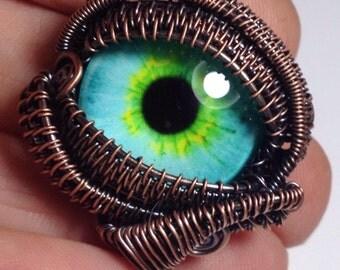 Woven wire wrapped human eye, zombie eye pendant