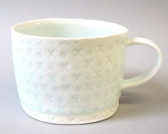 xo - porcelain cup with translucent bottom