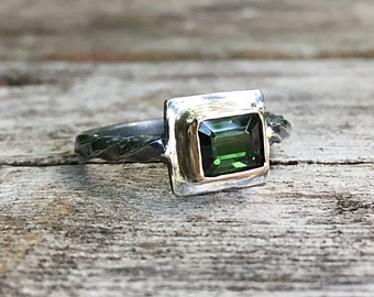 Rugged oxydized sterling silver ring with bottle green tourmaline bezel set in 10k gold