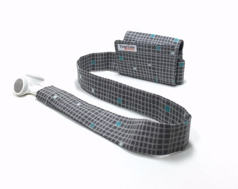 TuneTube earbud cord organizer for iPhone or iPod.  Cord keeper. Earbud holder. Earbud case.  Gray with turquoise squares.