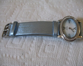 5 Dollar Listing Montres de FLEUR Oval Wristwatch with Rhinestone Trim and Light Blue Wristband