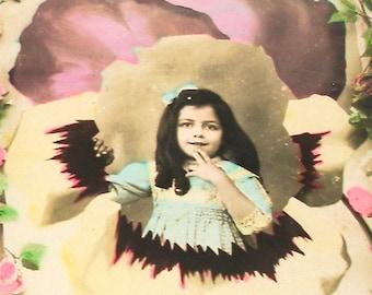1900s French postcard, Edwardian girl in a pansy flower, real photo postcard (RPPC), paper ephemera.