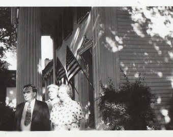 Original Vintage Photograph Man Women Pose by House & American Flags 1947