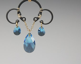 Europa v4: Bold industrial wire wrapped pendant with aquamarine Swarovski crystals