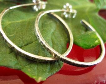 Sleek and simple lightly textured sterling silver hoop earrings on posts- one inch diameter