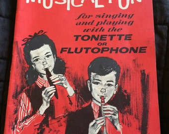 Old music book for tonette or flutophone - perect mixed media supply