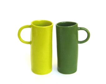 two whimsical hand built porcelain cups    ...  green and chartreuse   ...   pair of tall cups