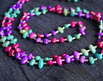 Vibrant Magenta, purple, and teal bead necklace with clear seed beads