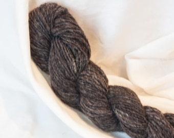 Handspun Shetland Yarn. Single ply. Natural Charcoal grey. Fiber grown by Caesar.