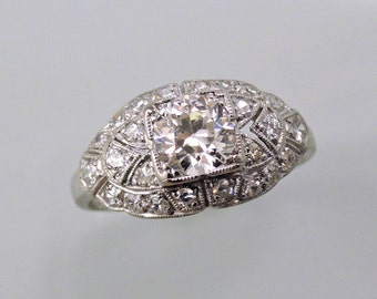 An Antique Platinum and Diamond Art Deco Engagement ring with Lovely Filigree Detail.  (A1728)