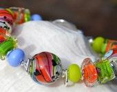 Reserve for Sandi-KALEIDOSCOPE-Handmade Lampwork and Sterling Silver Bracelet