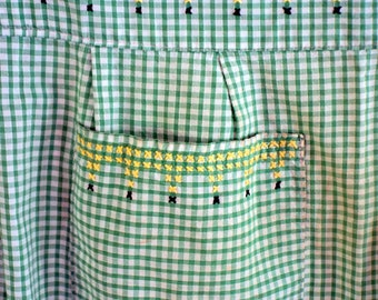 Green and white vintage gingham apron with black and yellow cross stitch